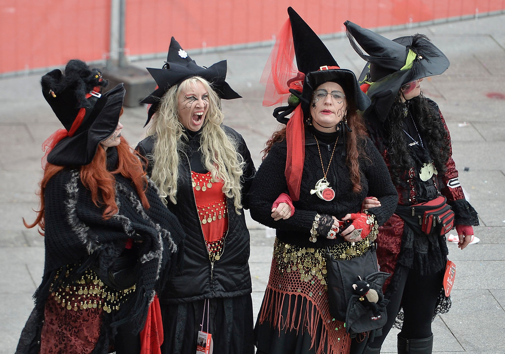 ". Four women are dressed us as witches when tens of thousands of revelers dressed in carnival costumes celebrate the start of the street-carnival on the so called ""Old Women\'s Day\"" in the party capital Cologne, Germany, Thursday, Feb. 27, 2014. (AP Photo/Martin Meissner)"
