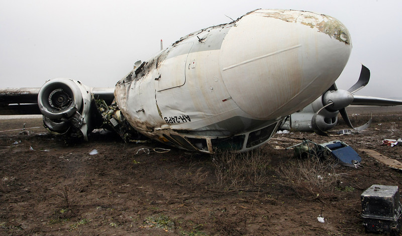 . A view of the debris of an An-24 plane which made an emergency landing in the eastern Ukraine city of Donetsk, on February 14, 2013. At least four people died yesterday when an Antonov An-24 passenger turboprop plane  with dozens of football fans on board made an emergency landing in Donetsk, officials said. The passengers were on their way to Donetsk to watch a match between Shakhtar Donetsk and Borussia Dortmund.  Alexander KHUDOTEPLY/AFP/Getty Images