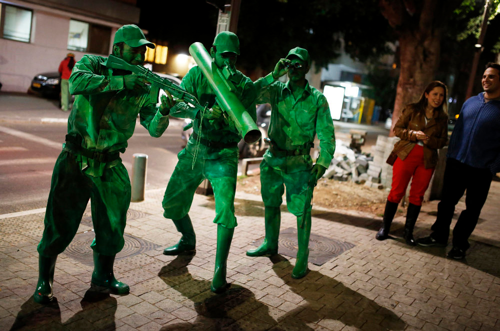 Description of . Israelis dressed as toy soldiers celebrate the Jewish holiday of Purim in Tel Aviv February 23, 2013. Purim is a celebration of the Jews\' salvation from genocide in ancient Persia, as recounted in the Book of Esther. Picture taken February 23, 2013. REUTERS/Amir Cohen