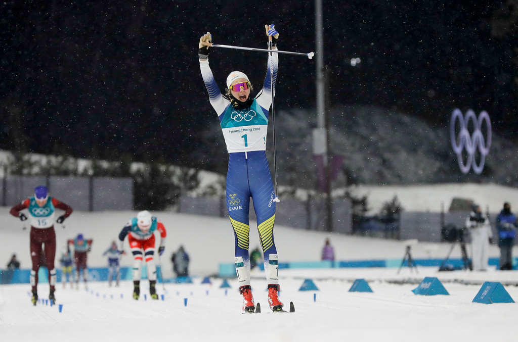 . Stina Nilsson, of Sweden, celebrates after winning the women\'s cross-country skiing sprint classic at the 2018 Winter Olympics in Pyeongchang, South Korea, Tuesday, Feb. 13, 2018. (AP Photo/Kirsty Wigglesworth)