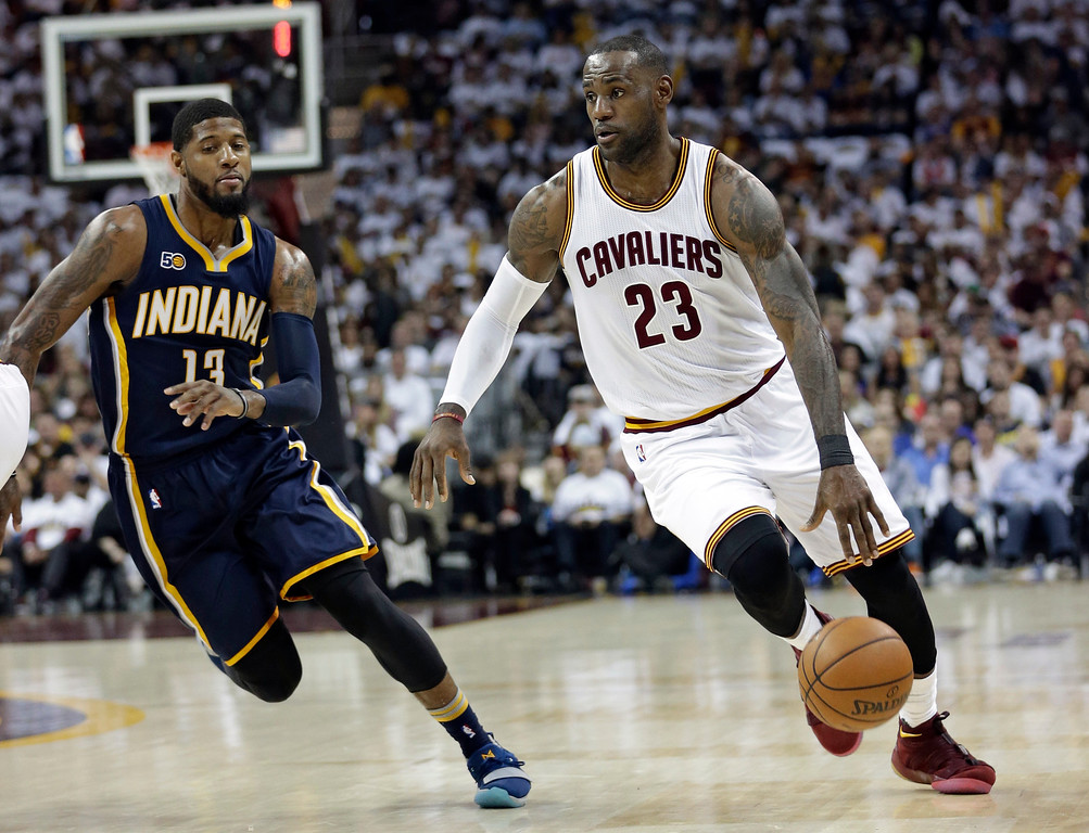. Cleveland Cavaliers\' LeBron James (23) drive spast Indiana Pacers\' Paul George (13) in the first half in Game 1 of a first-round NBA basketball playoff series, Saturday, April 15, 2017, in Cleveland. (AP Photo/Tony Dejak)