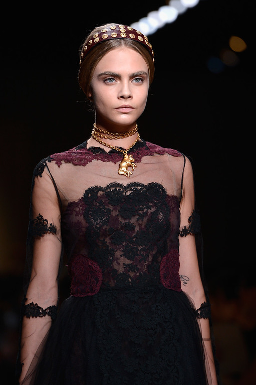 . Cara Delevingne walks the runway during Valentino  show as part of the Paris Fashion Week Womenswear  Spring/Summer 2014 at Espace Ephemere Tuileries on October 1, 2013 in Paris, France.  (Photo by Pascal Le Segretain/Getty Images)