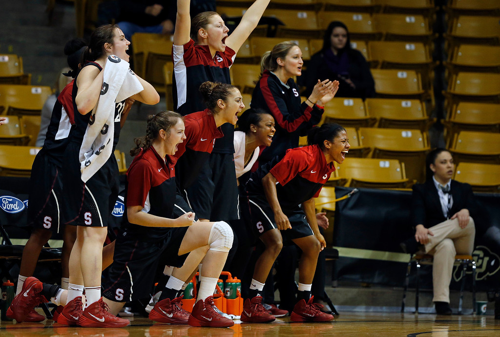 . Stanford\'s teammates celebrate a call that went in their favor, during the first half of an NCAA college basketball game against Colorado, in Boulder, Colo., Sunday, Jan. 12, 2014. Stanford went on to win 87-77. (AP Photo/Brennan Linsley)