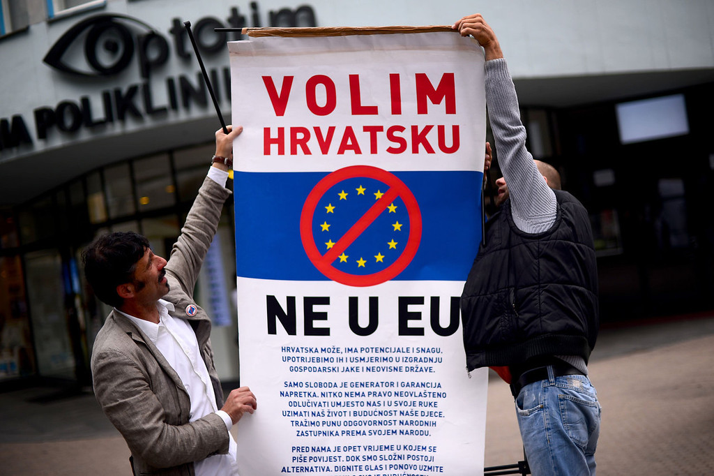 ". Croatian demonstrators display a poster reading ""We like Croatia, No in EU\"" during a protest against the entry of Croatia in the European Union in downtown Zagreb on June 29, 2013. Croatia will become on July 1, 2013 the 28th country to enter the European Union.  DIMITAR DILKOFF/AFP/Getty Images"