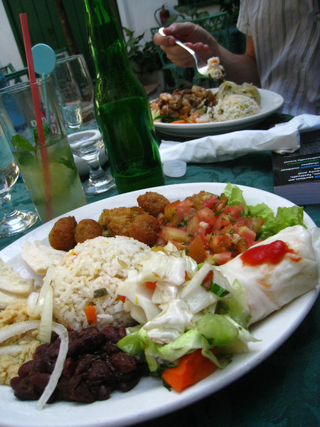 """Okay vegetarian platter: rice, pita, beans, """"falafel"""", tomato salad, hummus, and cabbage roll with the ubiquitous mojito"""