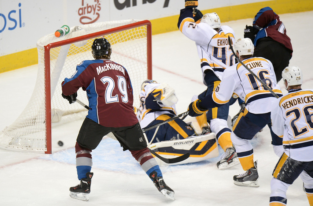 . DENVER, CO - OCTOBER 04 : PA Pareteau of Colorado Avalanche (15) scores from Goalie Pekka Rinne of Nashville Predators (35) with the assist of Nathan MacKinnon (29) in the 1st period of the game at Pepsi Center. Denver, Colorado. October 4, 2013. (Photo by Hyoung Chang/The Denver Post)