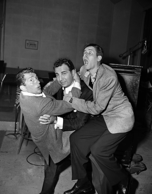 . Hijinks in front of film and TV cameras is not enough for Dean Martin, left, and Jerry Lewis, right, as they clown with orchestra leader Dick Stabile on a Hollywood movie lot, June 25, 1952. (AP Photo/Gerald K. Smith)