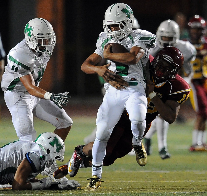 . Monrovia\'s Anthony Marquez (5) intercept a Arcadia pass in the first half of a prep football game at Arcadia High School in Arcadia, Calif. on Friday, Sept. 13, 2013.   (Photo by Keith Birmingham/Pasadena Star-News)