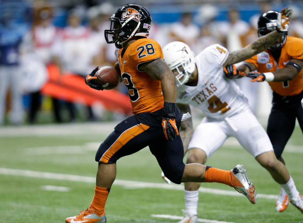 . Oregon State\'s Terron Ward (28) runs past Texas defender Kenny Vaccaro (4) to score a touchdown in the second quarter of the Alamo Bowl NCAA football game, Saturday, Dec. 29, 2012, in San Antonio.  (AP Photo/Eric Gay)