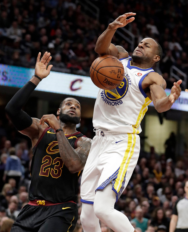 . Golden State Warriors\' Andre Iguodala (9) loses control of the ball under pressure from Cleveland Cavaliers\' LeBron James (23) in the second half of an NBA basketball game, Monday, Jan. 15, 2018, in Cleveland. (AP Photo/Tony Dejak)