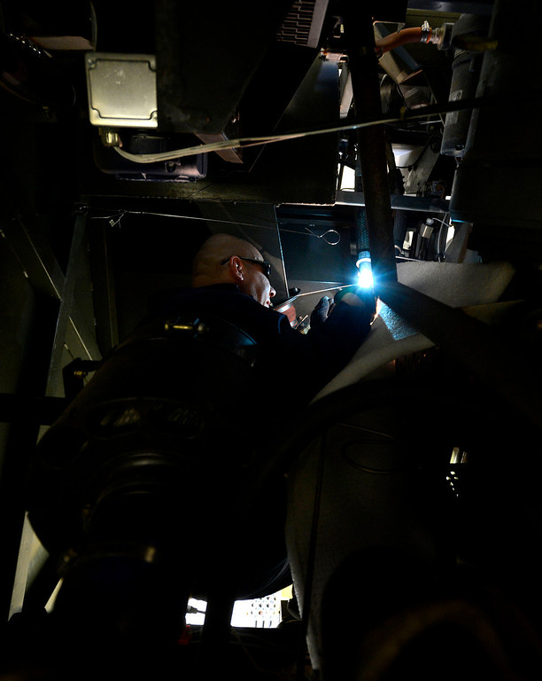 . Tech Sergeant Adrian Juarez repairs an aircraft air conditioning unit at March Air Reserve Base in Riverside March 6, 2013.  The base is one of many that will be affected by the Federal sequestration.  GABRIEL LUIS ACOSTA/STAFF PHOTOGRAPHER.
