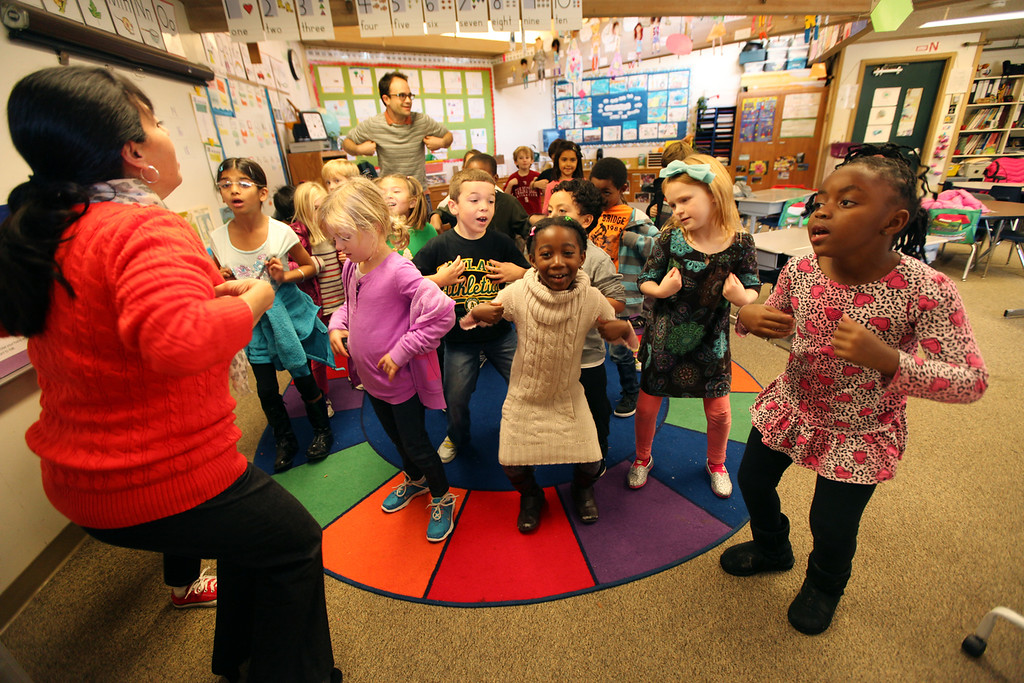 """. First grade teacher April Avila Ford, left, leads her students in the \""""Mrs. Gooney Bird\"""" song during class to help them get the wiggles out at Head Royce School in Oakland, Calif. on Monday, Dec. 3, 2012.  Head Royce is in it\'s 125th year of operation. (Laura A. Oda/Staff)"""