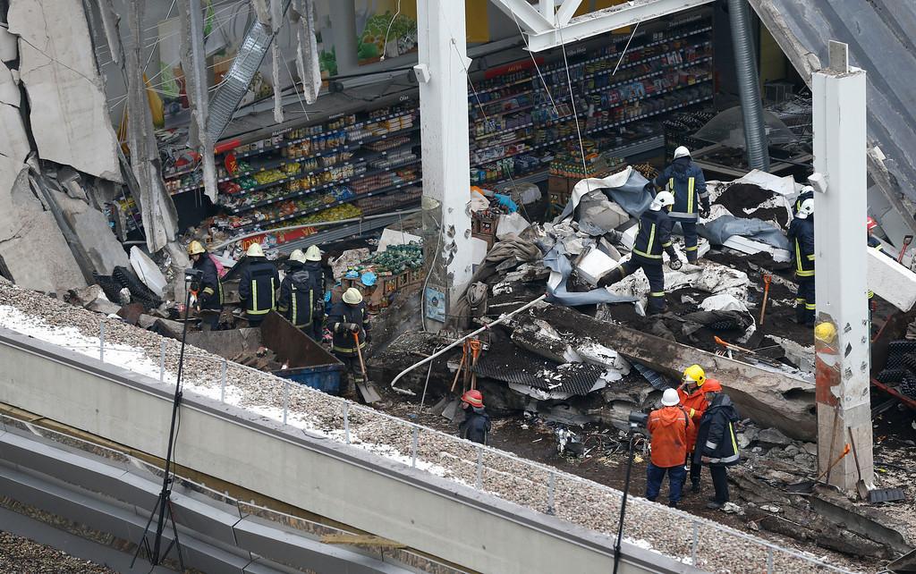 . Rescue workers search debris of the Maxima supermarket in Riga,  Latvia, Saturday, Nov. 23, 2013.  (AP Photo/Mindaugas Kulbis)
