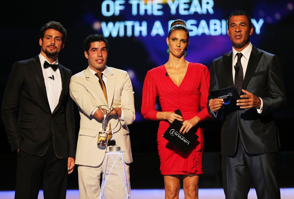""". Daniel Dias (2ndL) receives his award for \""""Laureus World Sportsperson of the Year with a Disablity\""""  from Caua Reymnd (L) and Fernanda Lima (2ndR) with Laureus Ambassador Ruud Gullit (R) during the awards show for the 2013 Laureus World Sports Awards at the Theatro Municipal Do Rio de Janeiro on March 11, 2013 in Rio de Janeiro, Brazil.  (Photo by Ian Walton/Getty Images For Laureus)"""