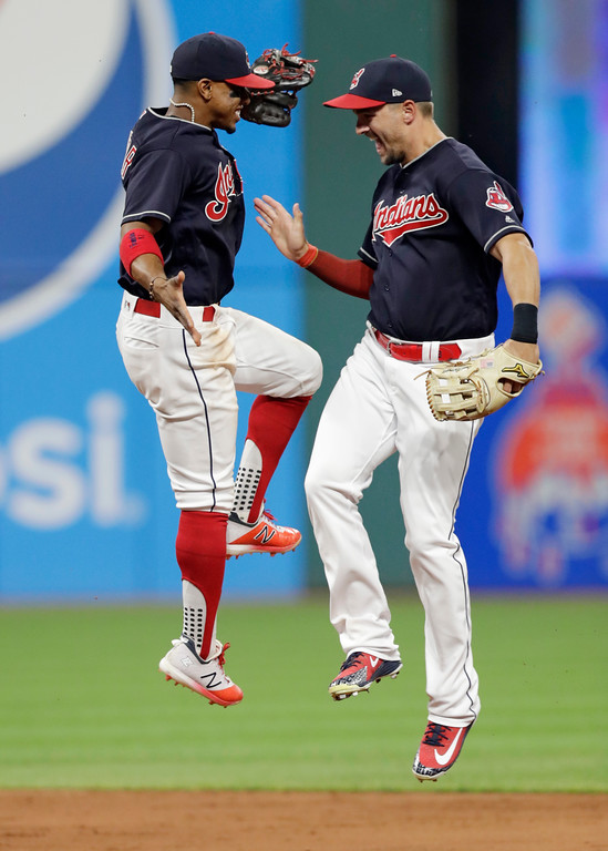 . Cleveland Indians\' Francisco Lindor, left, celebrates with Lonnie Chisenhall after the Indians defeated the Chicago White Sox 6-3 in a baseball game, Tuesday, June 19, 2018, in Cleveland. (AP Photo/Tony Dejak)
