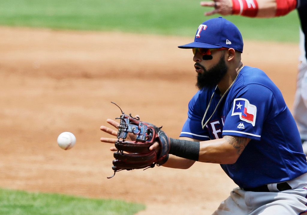 . Texas Rangers\' Rougned Odor fields a ball hit by Cleveland Indians\' Bradley Zimmer in the third inning of a baseball game, Thursday, June 29, 2017, in Cleveland. (AP Photo/Tony Dejak)