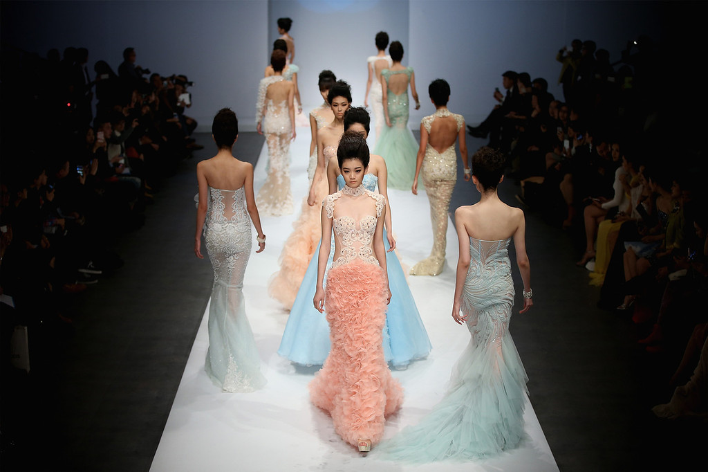 . BEIJING, CHINA - OCTOBER 26:  Models showcase designs by Chinese designer Zhang Jingjing on the runway at Zhang Jingjing Haute Couture Collection show during Mercedes-Benz China Fashion Week Spring/Summer 2014 at 751 D-PARK Central Halll on October 26, 2013 in Beijing, China.  (Photo by Feng Li/Getty Images)