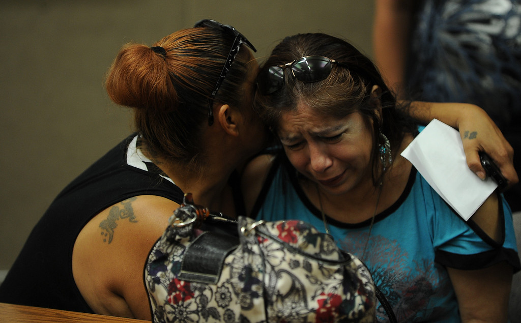 . Rosie Curonilla, right, mother of Daniel Olivera is comfort by a family member during a press conference at the San Bernardino County Sheriff\'s Head quarters Thursday August 22, 2013 in San Bernardino. Daniel Olivera 26, of Hesperia was shot and killed at the AM/PM Arco convenience store on August 11, 2013 in Victorville.LaFonzo Carter/Staff Photographer