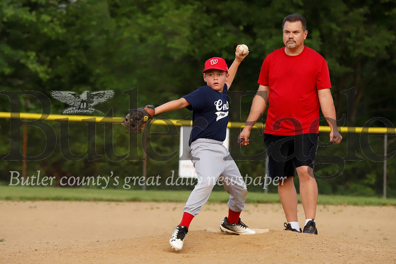 Andy Wolfe of the 8-10 year-old Center Township Nationals fires a pitch against the Butler W. Ricks team Tuesday, July 2. Seb Foltz Butler Eagle