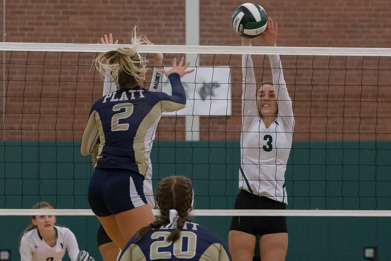 Maloney's Grace Anetrella block a spike attempt from Platt's Vanessa Isyk Monday at Maloney High School in Meriden October 2, 2017 | Justin Weekes / For the Record-Journal