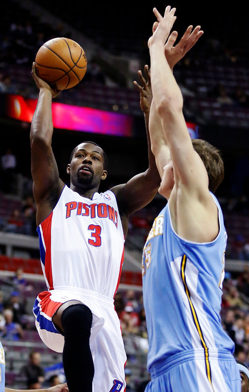 . Detroit Pistons guard Rodney Stuckey (3) shoots against Denver Nuggets center Timofey Mozgov (25) in the first half of an NBA basketball game, Tuesday, Dec. 11, 2012, in Auburn Hills, Mich. (AP Photo/Duane Burleson)