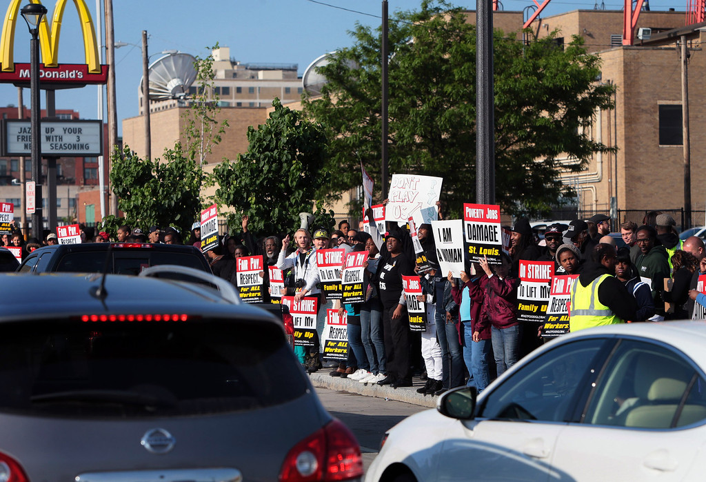 . More than 150 fast-food workers and protestors chant slogans promoting higher pay outside a McDonald\'s restaurant in St. Louis, Thursday, May 15, 2014.  (AP Photo/St. Louis Post-Dispatch, Laurie Skrivan)