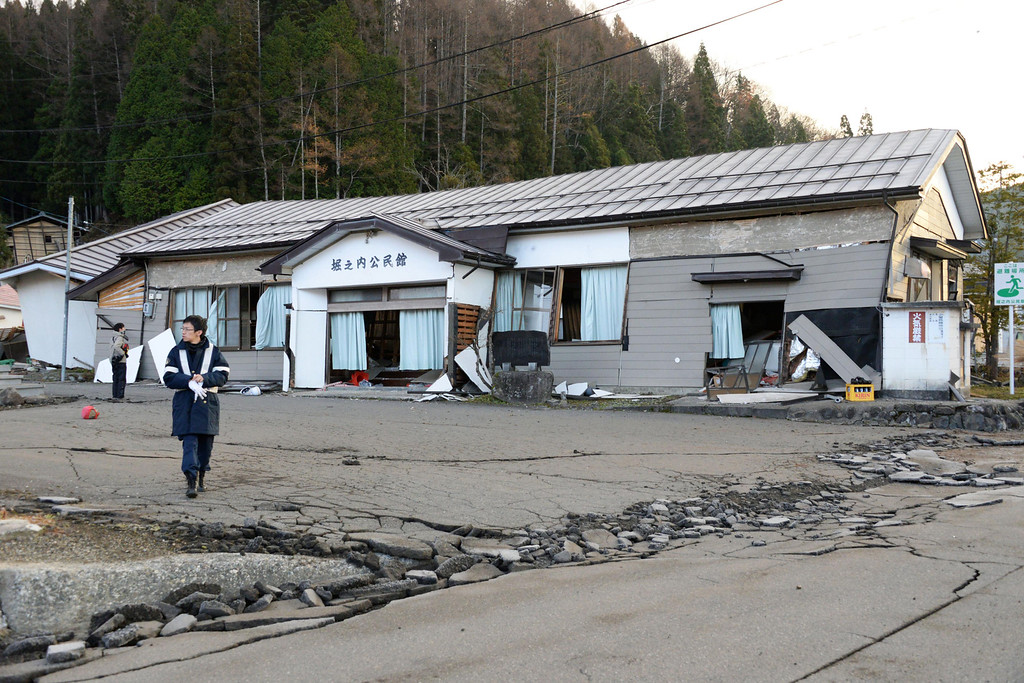 . A local community center stands damaged after a strong earthquake in Hakuba, Nagano prefecture, central Japan, Sunday, Nov. 23, 2014. More than 20 people have been hurt after the magnitude-6.8 earthquake shook on Saturday night the mountainous area that hosted the 1998 winter Olympics. (AP Photo/Kyodo News)