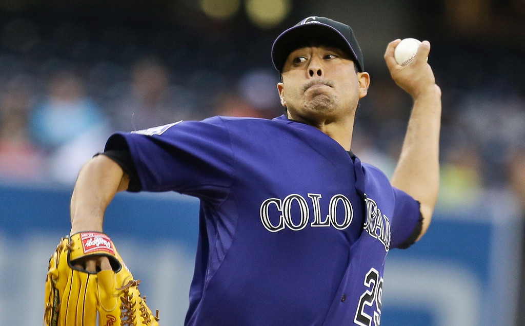 . Colorado Rockies starting pitcher Jorge De La Rosa throws against the San Diego Padres in the first inning of a baseball game in San Diego, Wednesday, July 10, 2013. (AP Photo/Lenny Ignelzi)