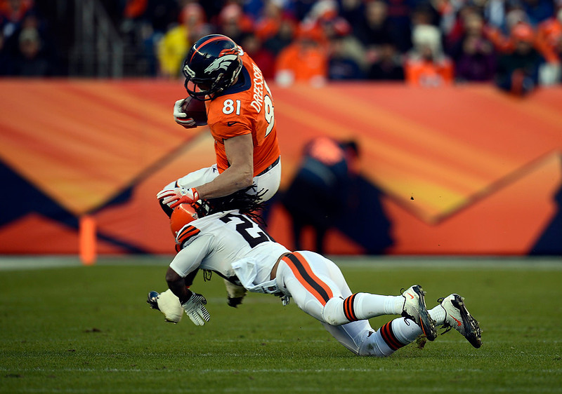 . Denver Broncos tight end Joel Dreessen (81) gains four yards against Cleveland Browns free safety Usama Young (28) during the first half.  The Denver Broncos vs Cleveland Browns at Sports Authority Field Sunday December 23, 2012. Joe Amon, The Denver Post