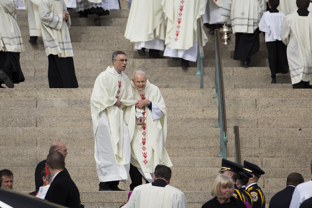 . Two members of the clergy watch people depart the funeral of the late Supreme Court justice Antonin Scalia at the Basilica of the National Shrine of the Immaculate Conception, February 20, 2016 in Washington, DC. Scalia, who died February 13 while on a hunting trip in Texas, layed in repose in the Great Hall of the Supreme Court on Friday and his funeral service will be at the basillica today.  (Photo by Drew Angerer/Getty Images)