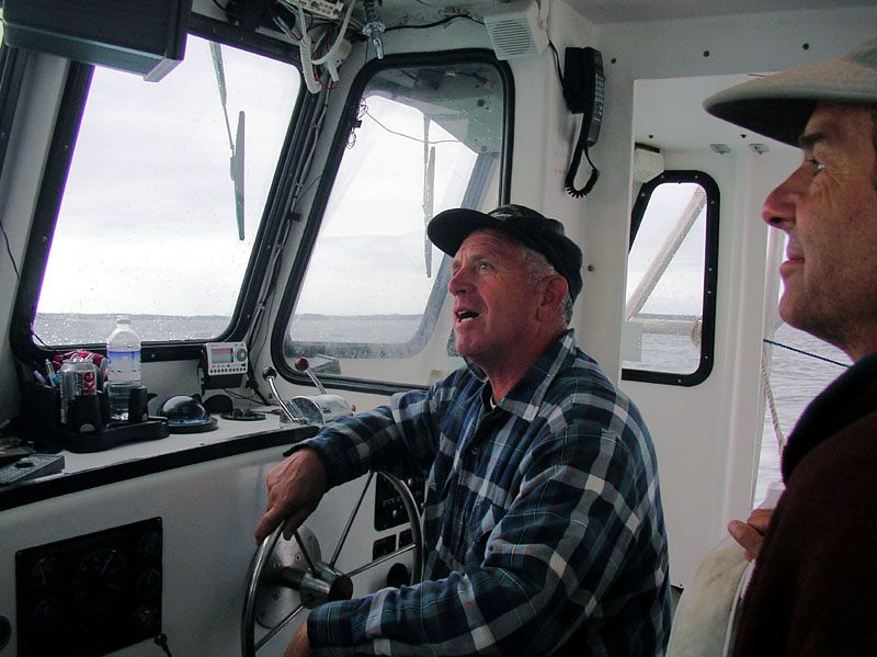 """Bobby Warren, our lobsterman, and trip home.  He says he uses herring for bait... I can confirm, since a bucket of herring """"stuff"""" spilled over onto our gear as the boat vrooooomed off.  Phewwww!"""