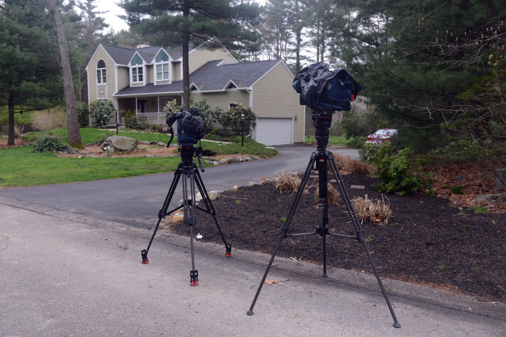 . Cameras stand outside the home of Warren and Judith Russell, where their daughter Katherine Tsarnaeva, the widow of Tamerlan Tsarnaev, is staying, on Coriander Lane April 23, 2013 in North Kingstown, Rhode Island. Tamerlan Tsarnaev, 26, along with his brother Dzhokhar Tsarnaev, 19, are the suspects in the Boston Marathon bombing. Tamerlan Tsarnaev was subsequently shot and killed after a car chase and shootout with police and Dzhokhar Tsarnaev was apprehended on a boat parked on a residential property in Watertown, Massachusetts. The bombing, on April 15 at the finish line of the marathon, killed three people and wounded at least 170.  (Photo by Darren McCollester/Getty Images)