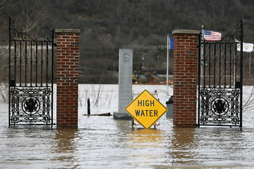 . Flood waters close Bellevue Beach Park, Sunday, Feb. 25, 2018, in Bellevue, Ky. The weather service said moderate flooding was expected along the Ohio River in Kentucky and Ohio, including in Cincinnati, where the river was 8 feet above flood stage Sunday. (Kareem Elgazzar/The Cincinnati Enquirer via AP)