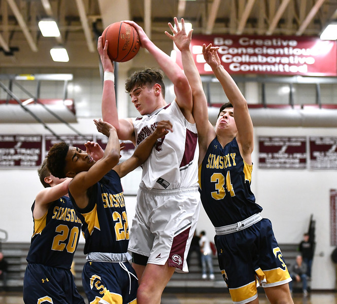 1/17/2020 Mike Orazzi | Staff Bristol Central's Donovan Clingan (32) under the hoop against Simsbury at Bristol Central Friday night.