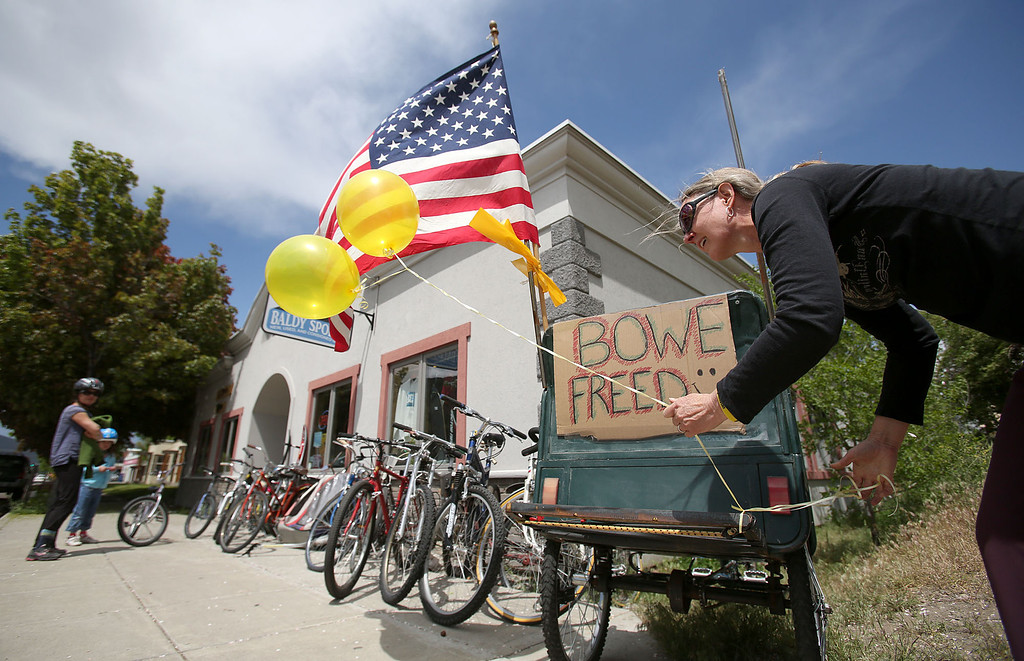 . Sondra Van Ert, co-owner of Baldy Sports, ties balloons to a bike trailer in front of her store to celebrate the news of U.S. Army Sgt. Bowe Bergdahl\'s release on Saturday, May 31, 2014 in Hailey, Idaho, his hometown. Bergdahl, 28, had been held prisoner by the Taliban since June 30, 2009. He was handed over to U.S. special forces by the Taliban in exchange for the release of five Afghan detainees held by the United States. (AP Photo/The Times-News, Ashley Smith)