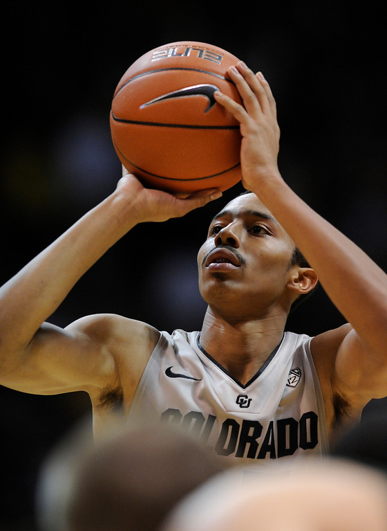 . Buffs point guard Spencer Dinwiddie concentrated a free-throw in the second half. The University of Colorado men\'s basketball team defeated Colorado State University 70-61 at the Coors Events Center Wednesday night, November 5, 2012. Karl Gehring/The Denver Post
