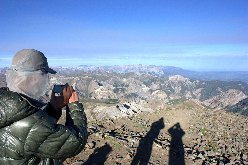. Junaid Dawud snaps a photo in the San Juan Mountains. Luke DeMuth and Dawud have hiked 1,300 miles and climbed 57 of the state\'s 58 14,000-foot peaks and plan to finish their 70-day mission Sunday on Longs Peak.