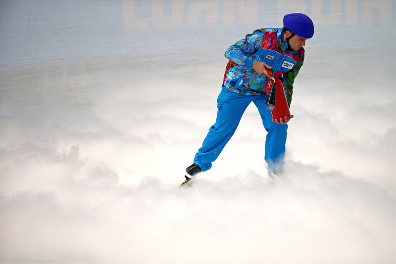 . A volunteer resurfaces the rink ahead of the Short Track Men\'s 500m Final A on day fourteen of the 2014 Sochi Winter Olympics at Iceberg Skating Palace on February 21, 2014 in Sochi, Russia.  (Photo by Clive Mason/Getty Images)