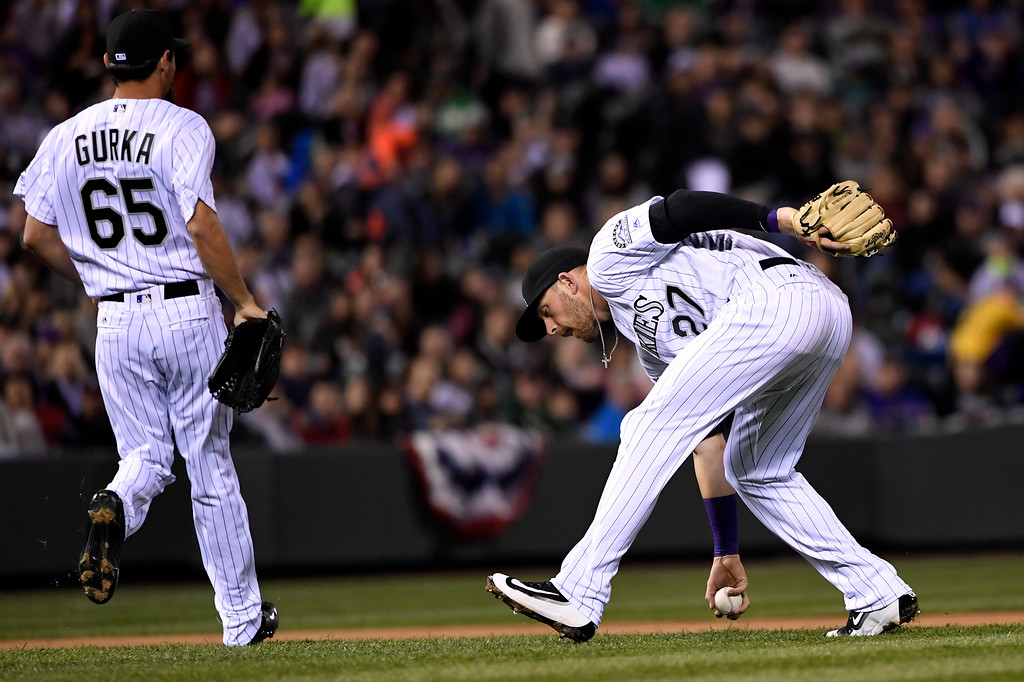 . Trevor Story (27) scooped up a ball tipped by Jason Gurka (65) of the Colorado Rockies against the San Diego Padres at Coors Field. April 09, 2016 in Denver, CO. (Photo By Joe Amon/The Denver Post)