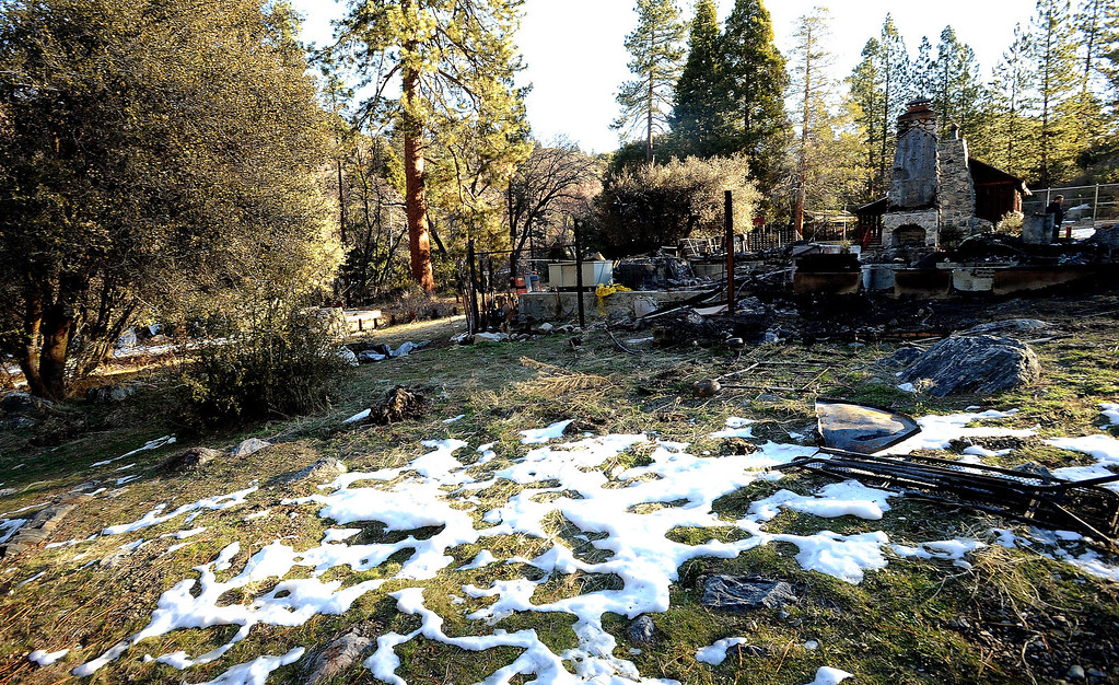 . A burned out cabin is all that remains of fugitive Christopher Dorner\'s last stand as seen  in Seven Oaks February 15, 2013.  (Staff photo by Gabriel Luis Acosta/The Sun)