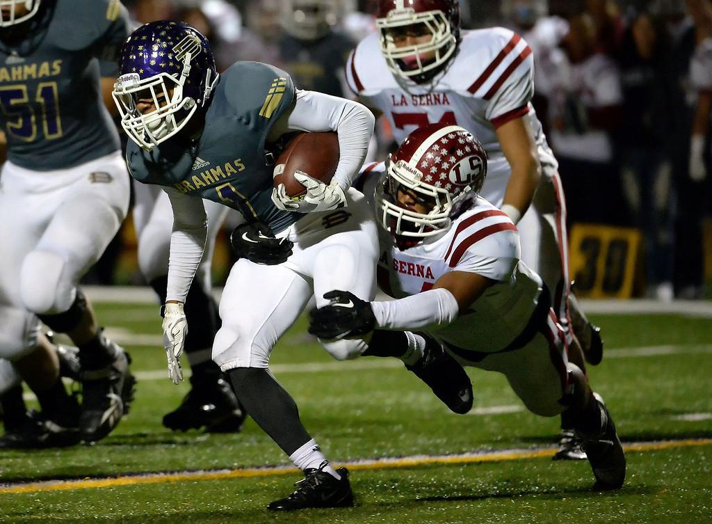 . Diamond Bar\'s Tyler Brown (C) (1) runs for yardage against La Serna in the first half of a CIF-SS playoff football game at Diamond Bar High School in Diamond Bar, Calif., on Friday, Nov. 22, 2013.   (Keith Birmingham Pasadena Star-News)