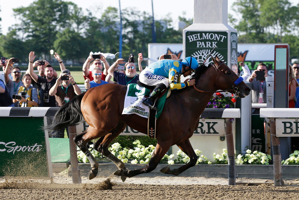 . American Pharoah (5) with Victor Espinoza up crosses the finish line to win the 147th running of the Belmont Stakes horse race at Belmont Park, Saturday, June 6, 2015, in Elmont, N.Y. American Pharoah is the first horse to win the Triple Crown since Affirmed won it in 1978. (AP Photo/Seth Wenig)