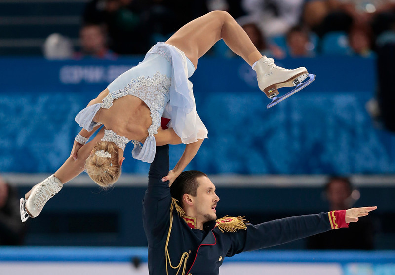 . Tatiana Volosozhar and Maxim Trankov of Russia compete in the team pairs short program figure skating competition at the Iceberg Skating Palace during the 2014 Winter Olympics, Thursday, Feb. 6, 2014, in Sochi, Russia. (AP Photo/Ivan Sekretarev)