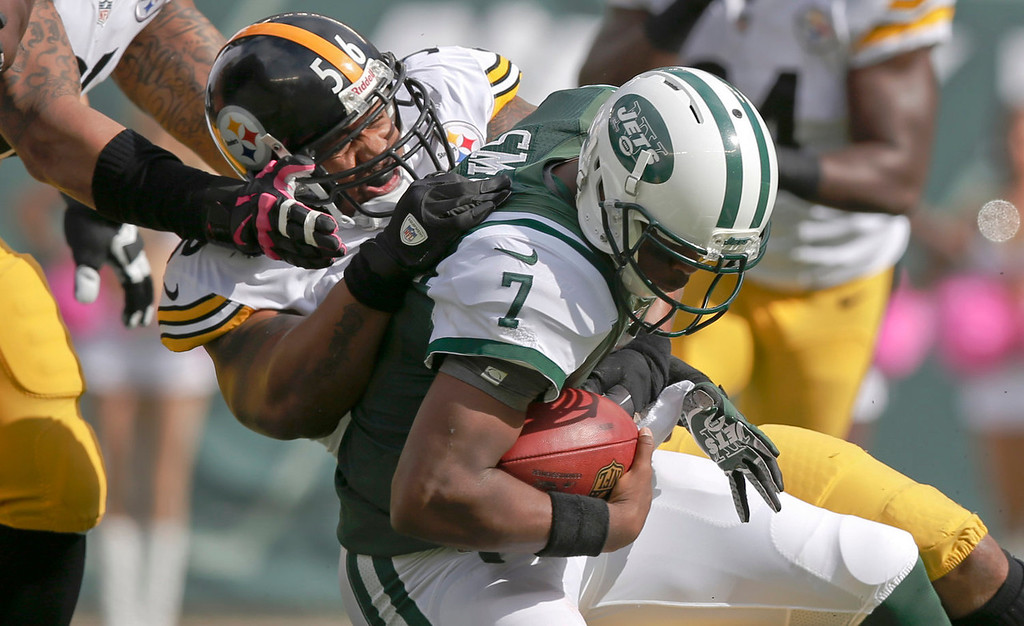 . Pittsburgh Steelers outside linebacker LaMarr Woodley (56) sacks New York Jets quarterback Geno Smith (7) during the first half of an NFL football game Sunday, Oct. 13, 2013, in East Rutherford, N.J.  (AP Photo/Kathy Willens)