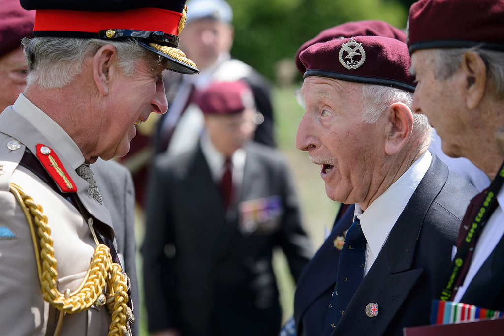 """. Britain\'s Prince Charles, left, meets British glider pilot World War II veterans during a D-Day commemoration event at the Pegasus bridge, in Benouville, western France, Thursday, June 5, 2014, marking the 70th anniversary of the World War II Allied landings in Normandy. June 6, 2014 marks the 70th anniversary of D-Day and \""""Operation Overlord\"""", a vast military operation by Allied forces in Normandy, which turned the tide of World War II, eventually leading to the liberation of occupied France and the end of the war against Nazi Germany. (AP Photo/Leon Neal, pool)"""