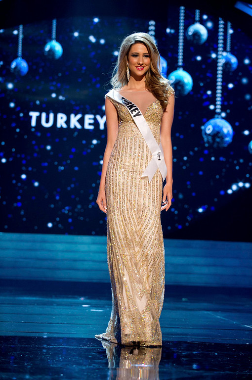 . Miss Turkey 2012 Cagil Ozge Ozkul competes in an evening gown of her choice during the Evening Gown Competition of the 2012 Miss Universe Presentation Show in Las Vegas, Nevada, December 13, 2012. The Miss Universe 2012 pageant will be held on December 19 at the Planet Hollywood Resort and Casino in Las Vegas. REUTERS/Darren Decker/Miss Universe Organization L.P/Handout