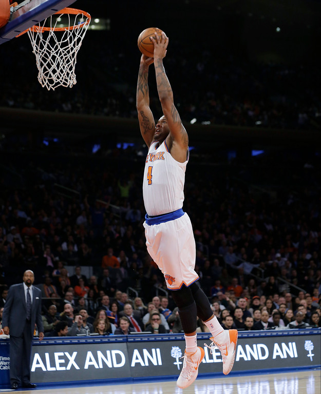 . New York Knicks\' Jeremy Tyler goes in for a dunk during the first half of an NBA basketball game against the Denver Nuggets on Friday, Feb. 7, 2014, in New York. The Knicks won 117-90. (AP Photo/Frank Franklin II)
