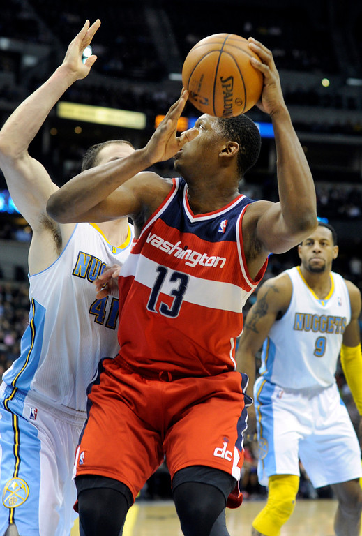 . DENVER, CO - JANUARY 18: Washington center Kevin Seraphin (13) worked his way to the bucket against Denver defender Kota Koufos (41) in the second half. The Washington Wizards defeated the Denver Nuggets 112-108 at the Pepsi Center Friday night, January 18, 2013. Karl Gehring/The Denver Post