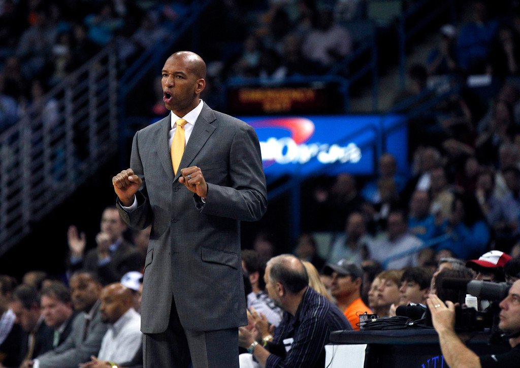 . New Orleans Hornets head coach Monty Williams calls out in the first half of an NBA basketball game against the Los Angeles Clippers in New Orleans, Wednesday, March 27, 2013. The Clippers won 105-91. (AP Photo/Gerald Herbert)