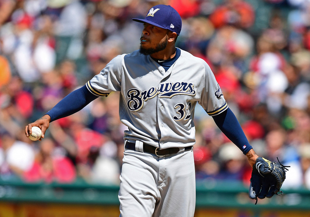 . Milwaukee Brewers relief pitcher Jeremy Jeffress reacts after walking Cleveland Indians\' Yonder Alonso with the bases loaded in the fifth inning of a baseball game, Wednesday, June 6, 2018, in Cleveland. (AP Photo/David Dermer)